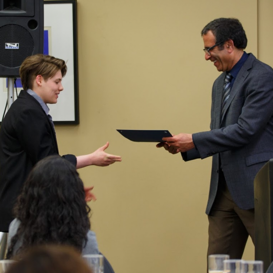 Student Receiving Award from Professor Rivkin